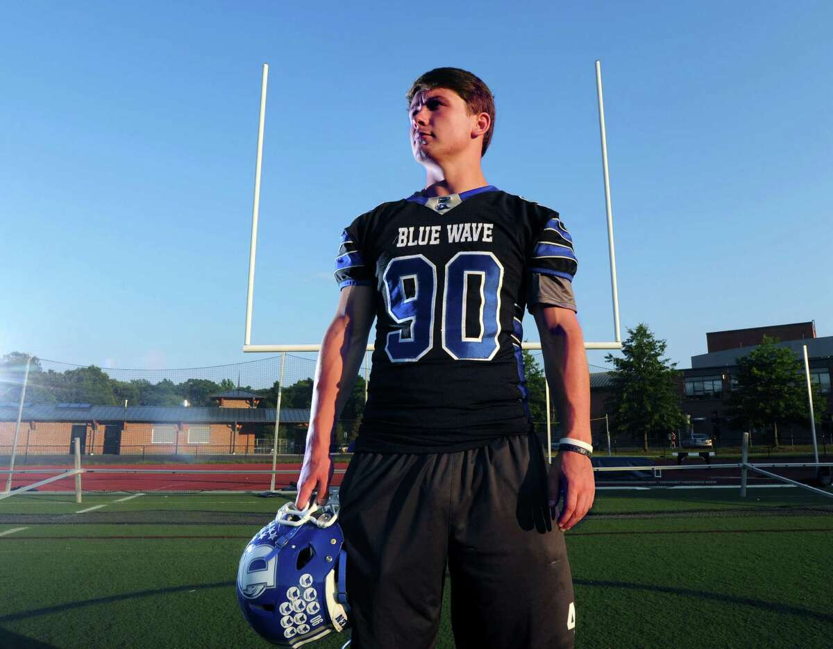 Darien's Mark Evanchick, Male Athlete of the Year, on the football field at Darien High School.