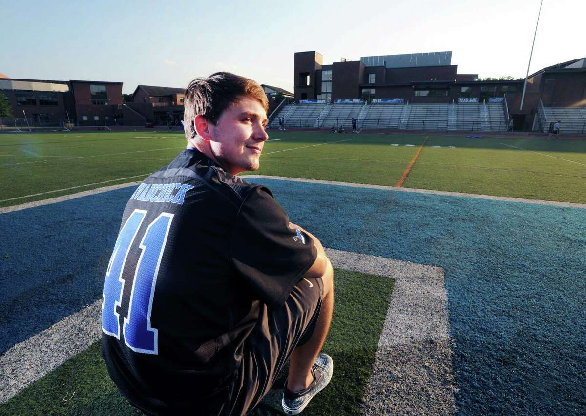 Darien High School's Mark Evanchick, Male Athlete of the Year, on the football field at Darien High School, Wednesday, July 6, 2016, where he starred in football and lacrosse. Evanchick said he will be attending the University of Pennsylvania where he said he will play lacrosse.