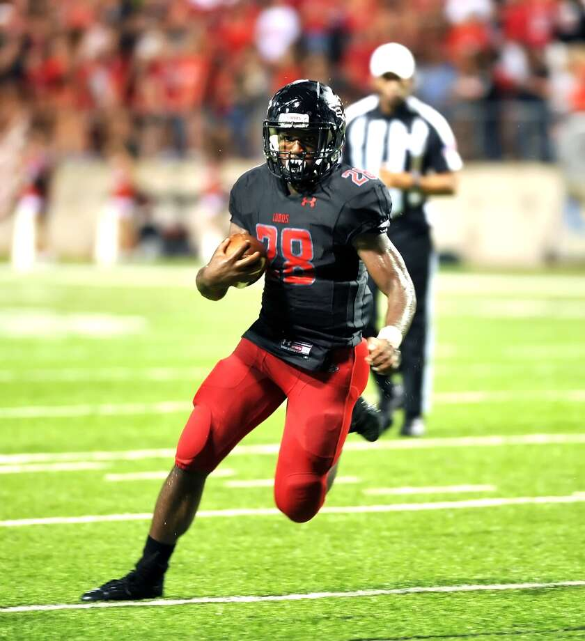 Cy Falls and Langham Creek football teams met at The Berry Center for a 17-6A game, 9-1092015.  Cy Falls won the game, 33-30. Langham Creek's Toneil Carter (8) found plenty of running room against Cy Falls. Photo: Eddy Matchette, For The Chronicle / Freelance