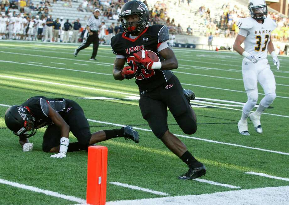 Langham Creek running back Toneil Carter runs in for a touchdown during the first half of a high school football game against Cypress Ranch at the Berry Center on Saturday, Sept. 20, 2014, in Cypress. Photo: J. Patric Schneider, For The Chronicle / © 2014 Houston Chronicle