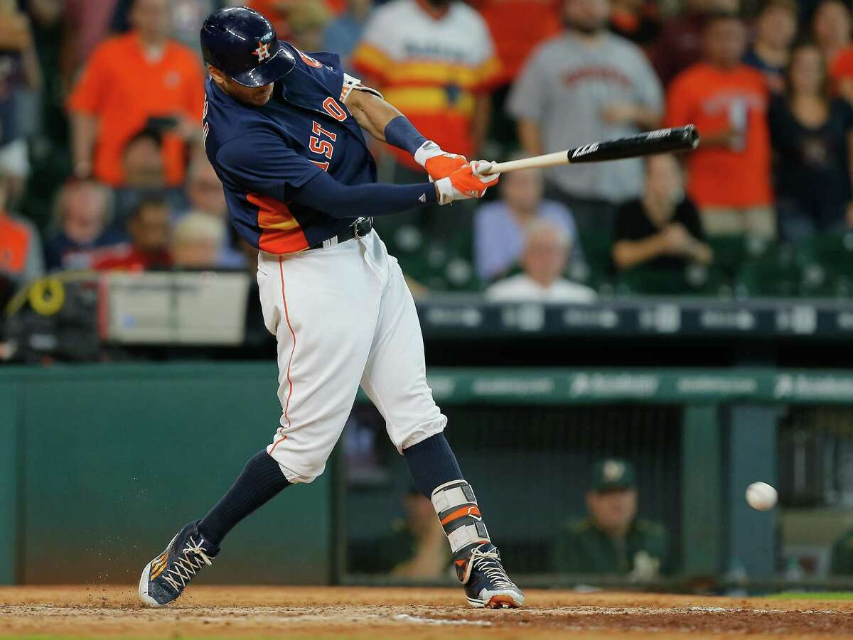 HOUSTON, TX - JULY 10: Carlos Correa #1 of the Houston Astros singles in the ninth inning to score the winning run against the Oakland Athletics at Minute Maid Park on July 10, 2016 in Houston, Texas.