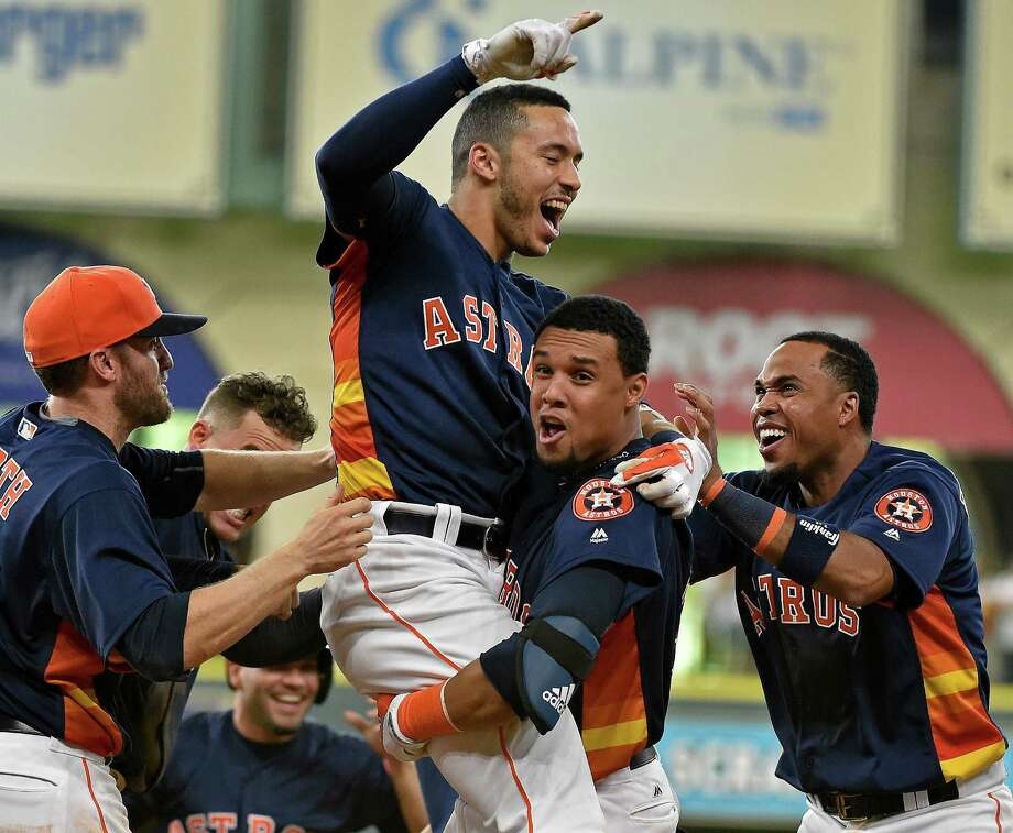 Houston Astros' Carlos Correa celebrates his game-winning RBI single with Carlos Gomez and teammates in the 10th inning of a baseball game against the Oakland Athletics, Sunday, July 10, 2016, in Houston. Houston won 2-1. (AP Photo/Eric Christian Smith) Photo: Eric Christian Smith, Associated Press / FR171023 AP