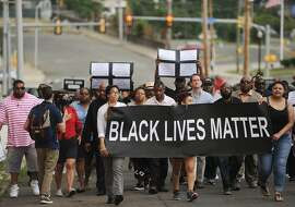 Hundreds of Black Lives Matter protesters march up Congress Street to police headquarters in Bridgeport, Conn. on Sunday, July 10, 2016. Protesters marched from Mount Aery Baptist Church on Frank Street to protest last week's killing of black men by police officers in Louisiana and Minnesota.