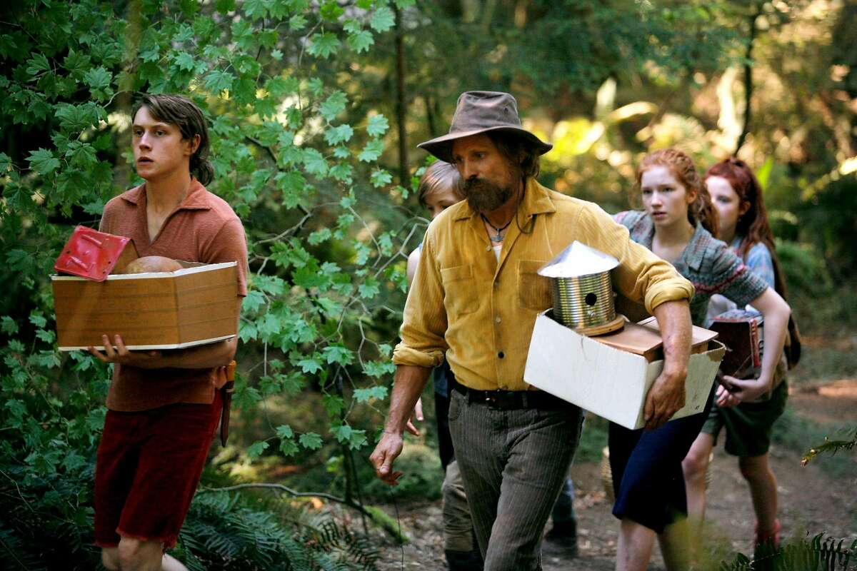 """In this image released by Bleecker Street, George MacKay, from left, Viggo Mortensen, Annalise Basso and Samantha Isle appear in a scene from, """"Captain Fantastic."""" (Erik Simkins/Bleecker Street via AP)"""