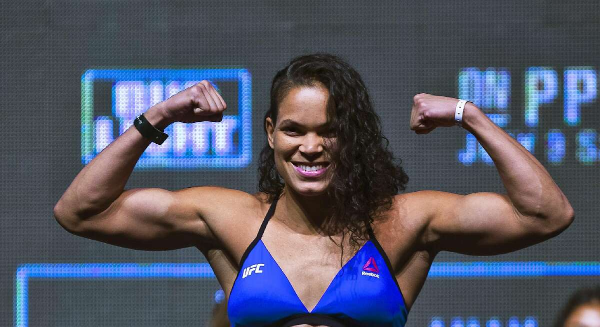 Amanda Nunes poses for photos during the UFC 200 weigh-ins in Las Vegas, Friday, July 8, 2016. (L.E. Baskow/Las Vegas Review-Journal via AP)