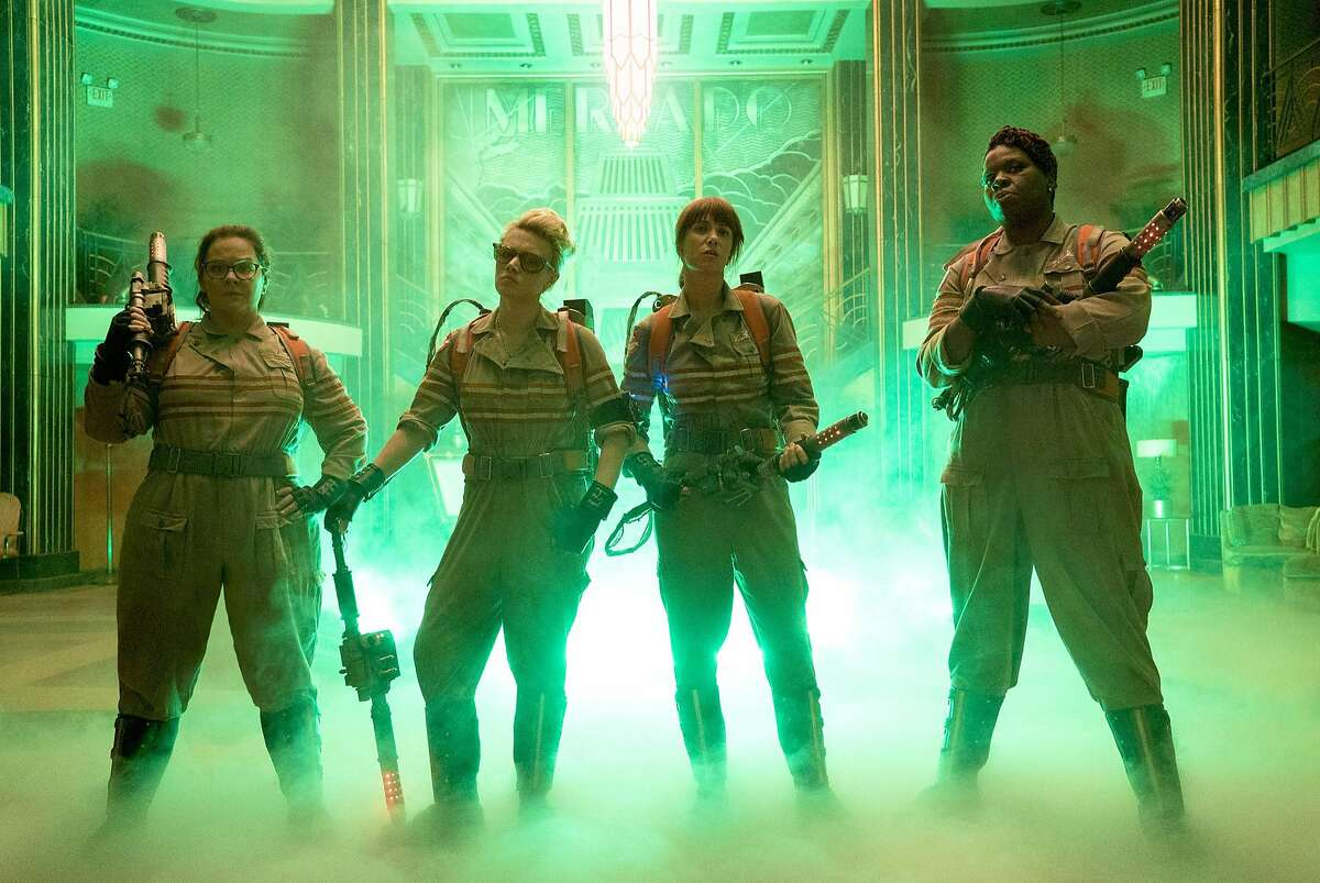 """This image released by Sony Pictures shows, from left, Melissa McCarthy, Kate McKinnon, Kristen Wiig and Leslie Jones in a scene from """"Ghostbusters,"""" opening nationwide on July 15. (Hopper Stone/Columbia Pictures/Sony Pictures via AP)"""