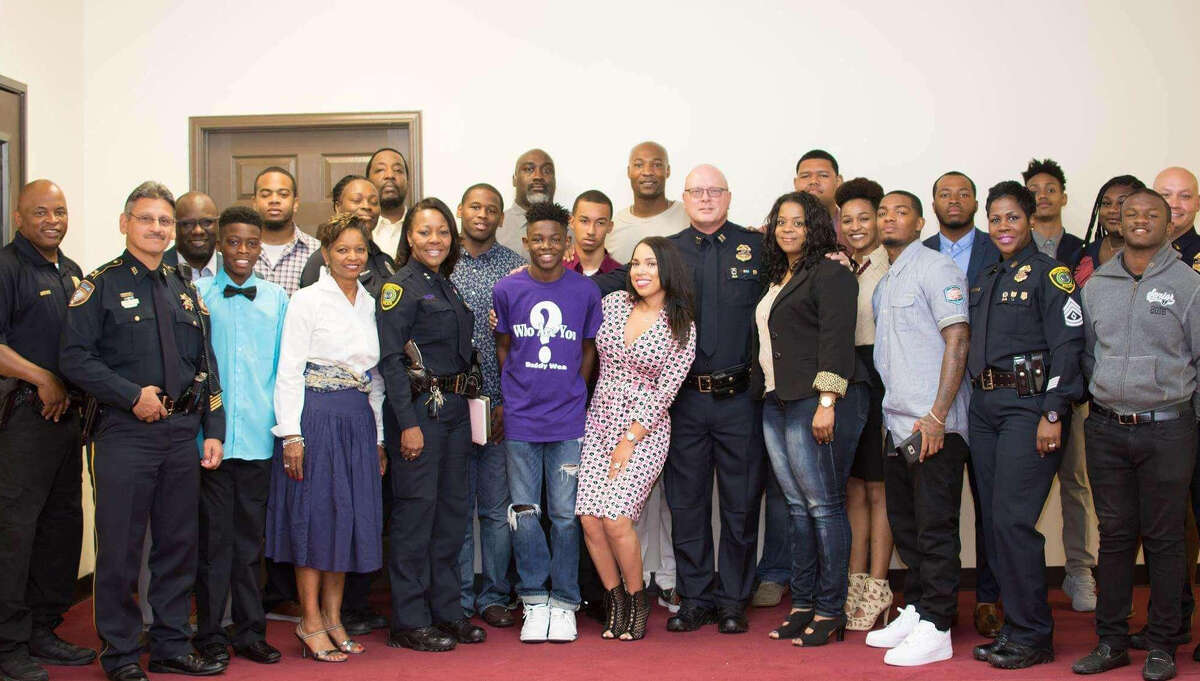 This one is from the lede scene at the Lighthouse Church, with Pastor Keion Henderson, Capt. Greg Fremin, and other members of the church and HPD. ( Lydia Depillis / Houston Chronicle )