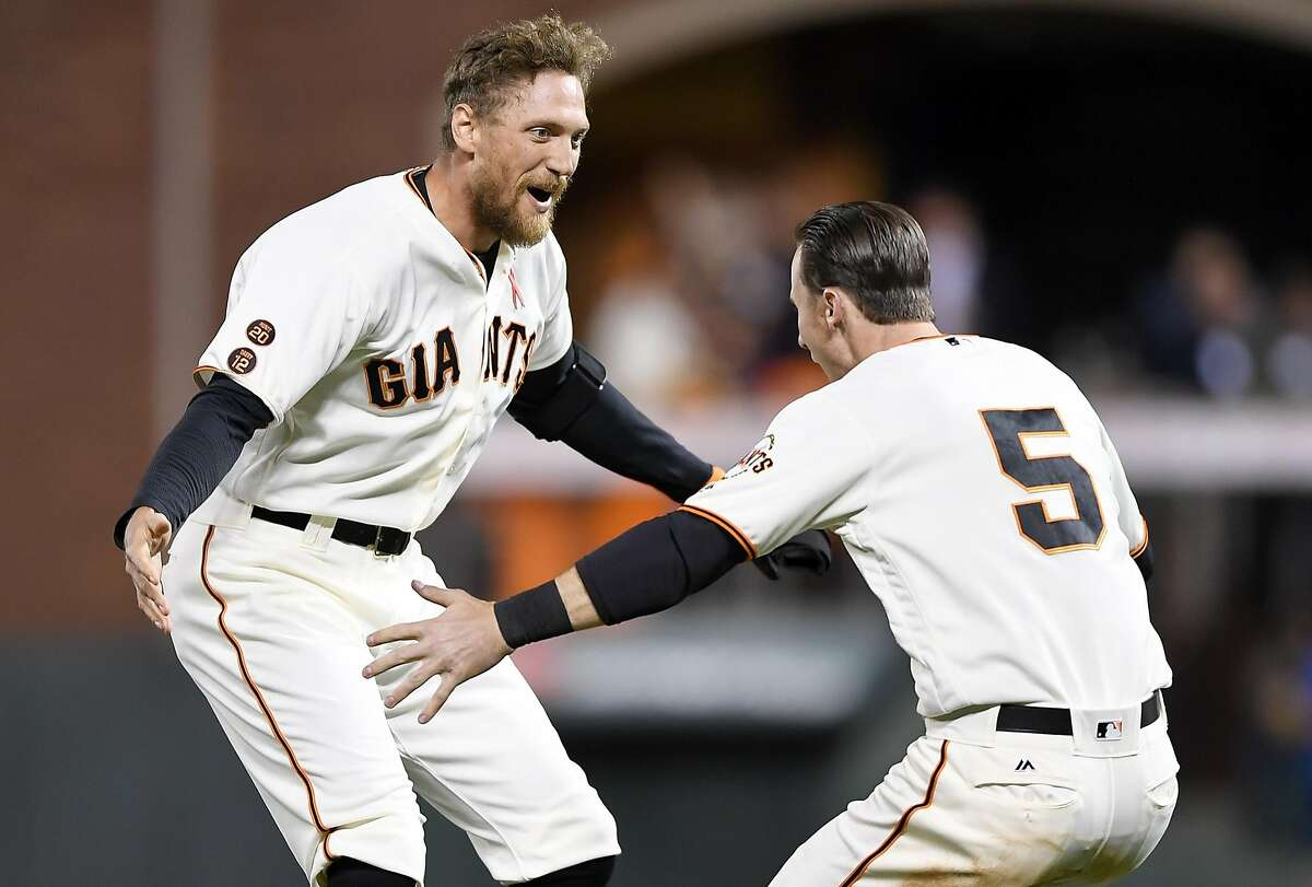SAN FRANCISCO, CA - MAY 23: Hunter Pence #8 and Matt Duffy #5 of the San Francisco Giants celebrates after Pence hit a walk-off rbi single to score Brandon Belt #9 (not pictured) against the San Diego Padres in the bottom of the ninth inning at AT&T Park on May 23, 2016 in San Francisco, California. The Giants won the game 1-0. (Photo by Thearon W. Henderson/Getty Images)