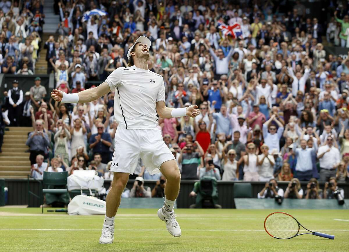 Andy Murray of Britain celebrates after beating Milos Raonic of Canada in the men's singles final on the fourteenth day of the Wimbledon Tennis Championships in London, Sunday, July 10, 2016. (AP Photo/Kirsty Wigglesworth)