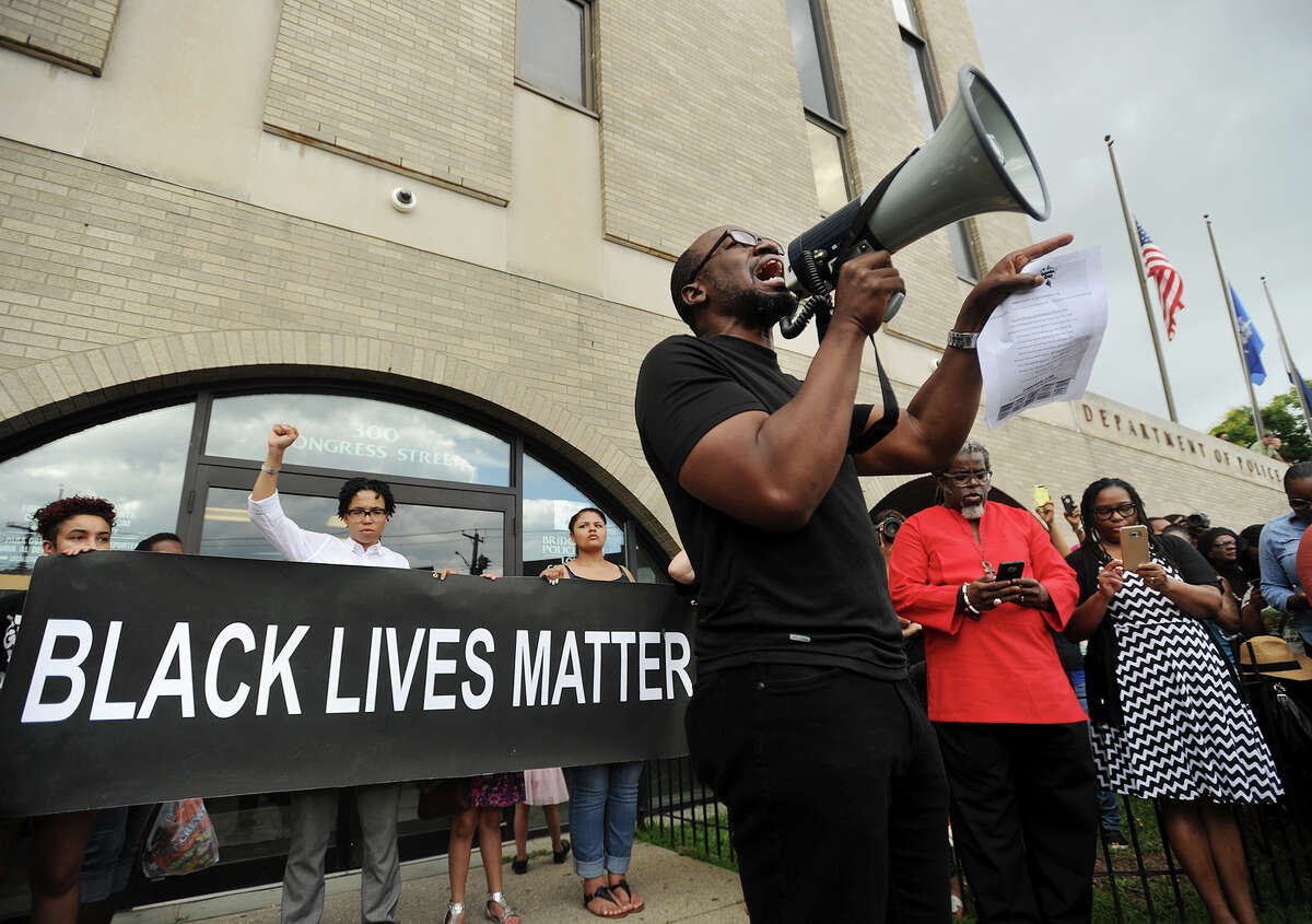 Activist Kevin Muhammad, of Bridgeport, speaks to a large Black Lives Matter protest in front of Police Headquarters on Congress Street in Bridgeport, Conn. on Sunday, July 10, 2016. Several hundred protesters marched from Mount Aery Baptist Church on Frank Street to protest last week's killing of black men by police officers in Louisiana and Minnesota.