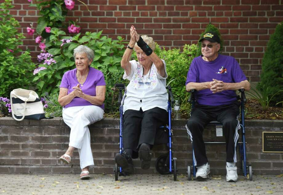 Cos Cob resident Anna Ferraro, left, and Greenwich residents Phyllis and John Stein clap along to the beat of the music during the Dixieland Jazz on the Sound concert at the Island Beach Ferry dock in Greenwich, Conn. Sunday, July 10, 2016. A small crowd gathered to watch traditional New Orleans jazz band the Hedge Fund Rascals perform. The next Dixieland Jazz concert will be August 7. Photo: Tyler Sizemore, Hearst Connecticut Media / Greenwich Time