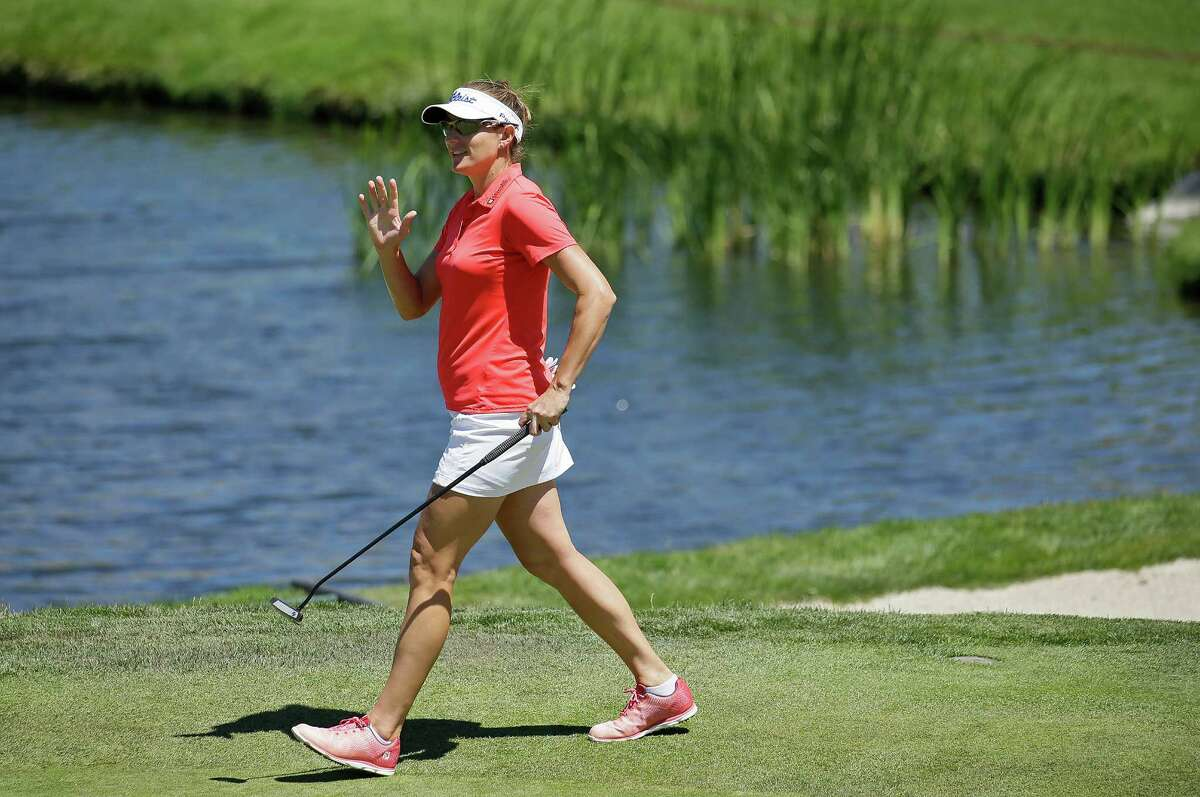 Brittany Lang waves to the gallery while walking to the fifth green during the final round of the U.S. Women's Open golf tournament at CordeValle, Sunday, July 10, 2016, in San Martin, Calif.