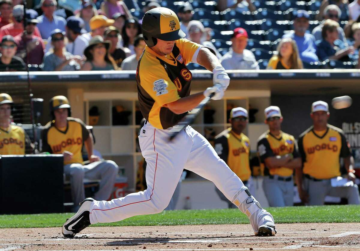 U.S. Team's Alex Bregman, of the Houston Astros, connects for a triple against the World Team during the first inning of the All-Star Futures baseball game, Sunday, July 10, 2016, in San Diego. (AP Photo/Lenny Ignelzi)