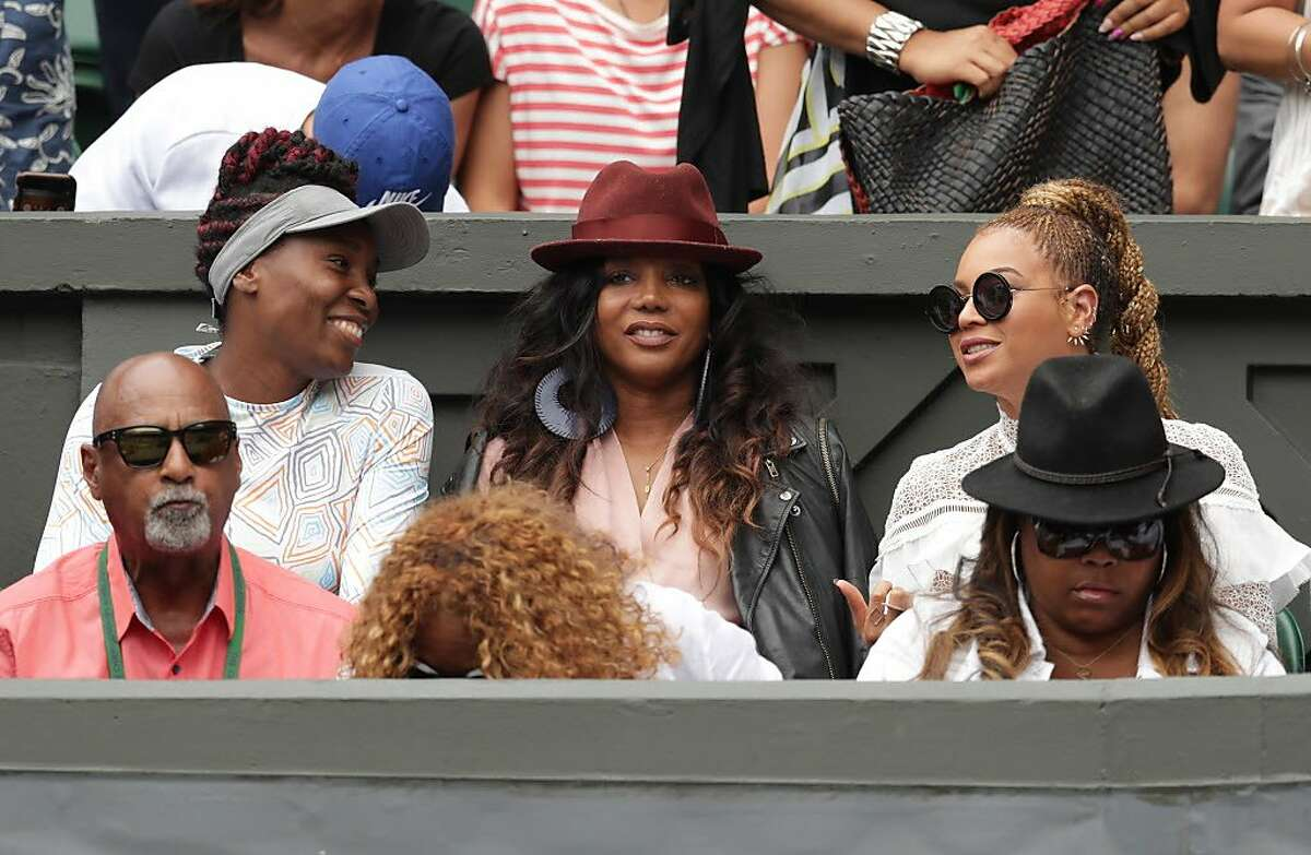 Venus Williams of The United States and Beyonce watch on as Serena Williams of The United States and Angelique Kerber of Germany play in the Ladies Singles Final match on day twelve of the Wimbledon Lawn Tennis Championships at the All England Lawn Tennis and Croquet Club on July 9, 2016 in London, England.