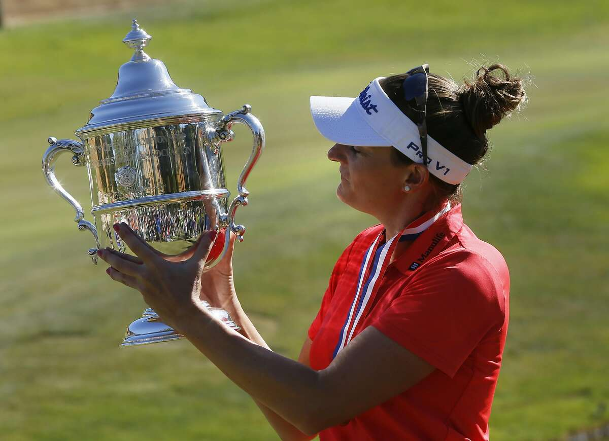 Brittany Lang holds the championship trophy as the winner of 2016 U.S. Women's Open Championship at CordeValle in San Martin, California, on Sun. July 10, 2016.