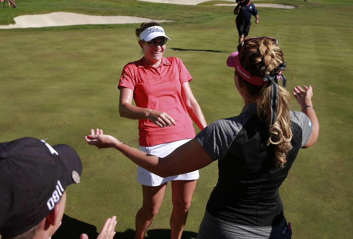 Brittany Lang, (left) is congratulated by Paula Creamer as the winner of the 2016 U.S. Women's Open Championship at CordeValle in San Martin, California, on Sun. July 10, 2016.