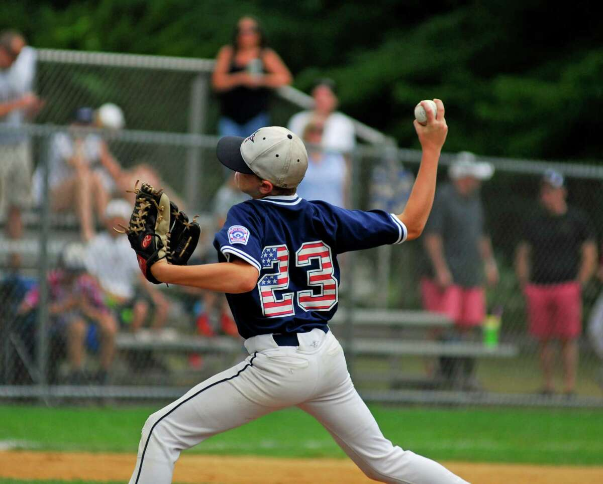 Westport pitcher Cutter Frost throws a pitch during a District 2 tournament game against Trumbull National on Sunday at Unity Park in Trumbull.