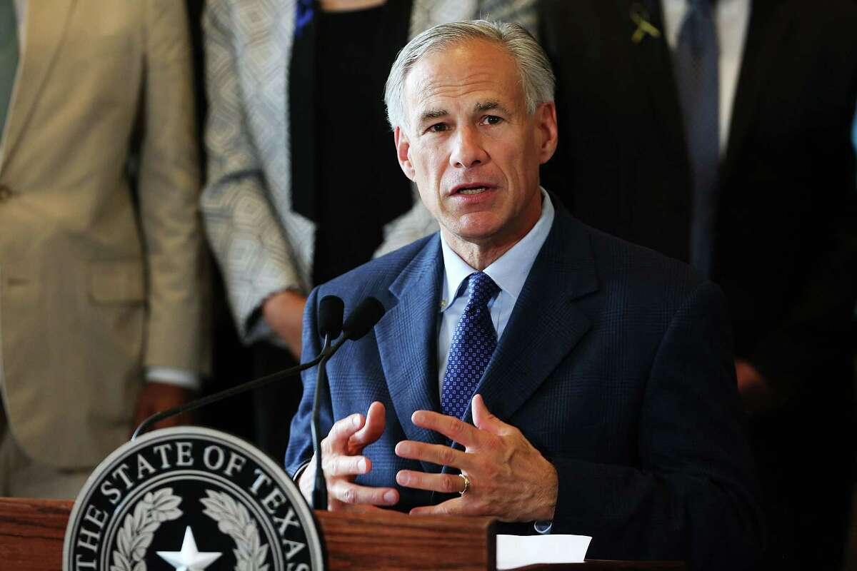 Texas Gov. Greg Abbott speaks at Dallas' City Hall on Friday, a day after the killings of five police officers at a protest.