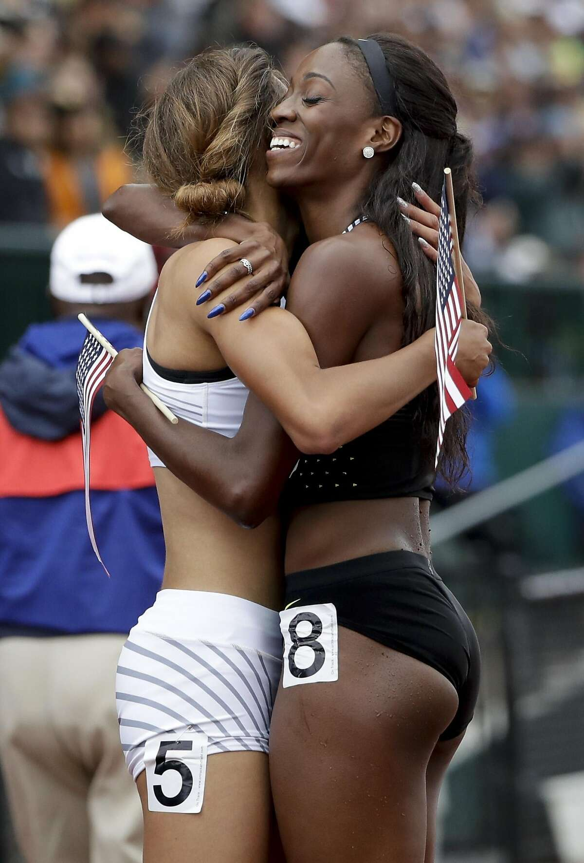 Dalilah Muhammad, right, winner in the finals of the women's 400-meter hurdles hugs Sydney McLaughlin, third place finisher, at the U.S. Olympic Track and Field Trials, Sunday, July 10, 2016, in Eugene Ore. (AP Photo/Marcio Jose Sanchez)