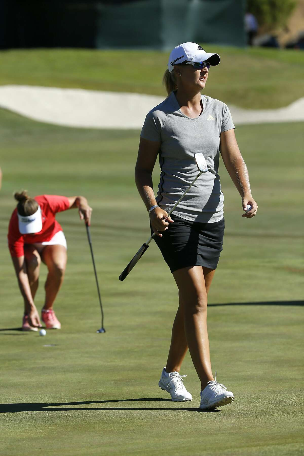 Anna Nordqvist walks off the final hole in her playoff with Brittany Lang, (back) who would win the 2016 U.S. Women's Open Championship at CordeValle in San Martin, California, on Sun. July 10, 2016.