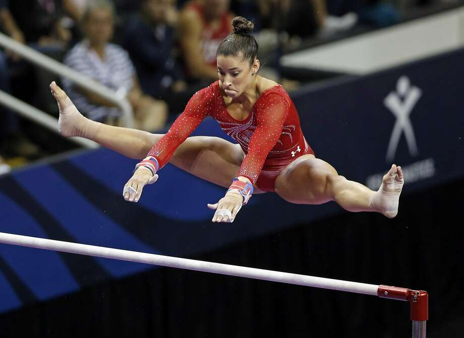 Aly Raisman performs on uneven bars during Day 2 of 2016 U.S. Olympic Trials for Women's Gymnastics at SAP Center in San Jose, Calif., on Sunday, July 10, 2016. Photo: Scott Strazzante, The Chronicle