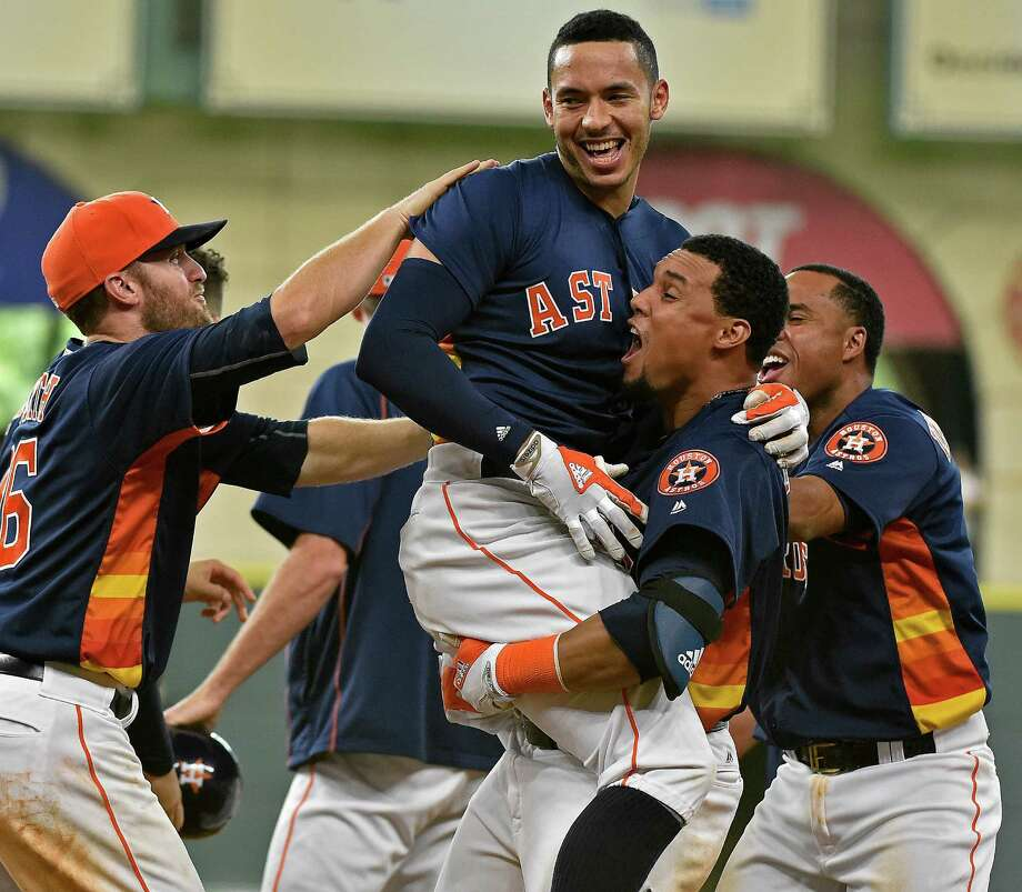 Carlos Correa (center) and the Astros were playing some of their best ball this season entering the All-Star break. Photo: Eric Christian Smith, FRE / FR171023 AP