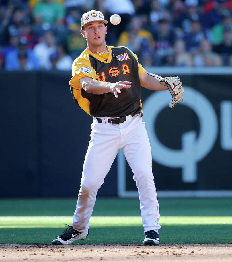 U.S. Team's Alex Bregman, of the Houston Astros, throws against the World Team during the fifth inning of the All-Star Futures baseball game, Sunday, July 10, 2016, in San Diego. (AP Photo/Lenny Ignelzi) Photo: Lenny Ignelzi, Associated Press / AP