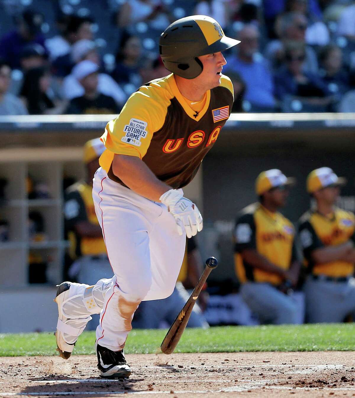 U.S. Team's Alex Bregman, of the Houston Astros, connects for a base hit against the World Team during the third inning of the All-Star Futures baseball game, Sunday, July 10, 2016, in San Diego. (AP Photo/Lenny Ignelzi)