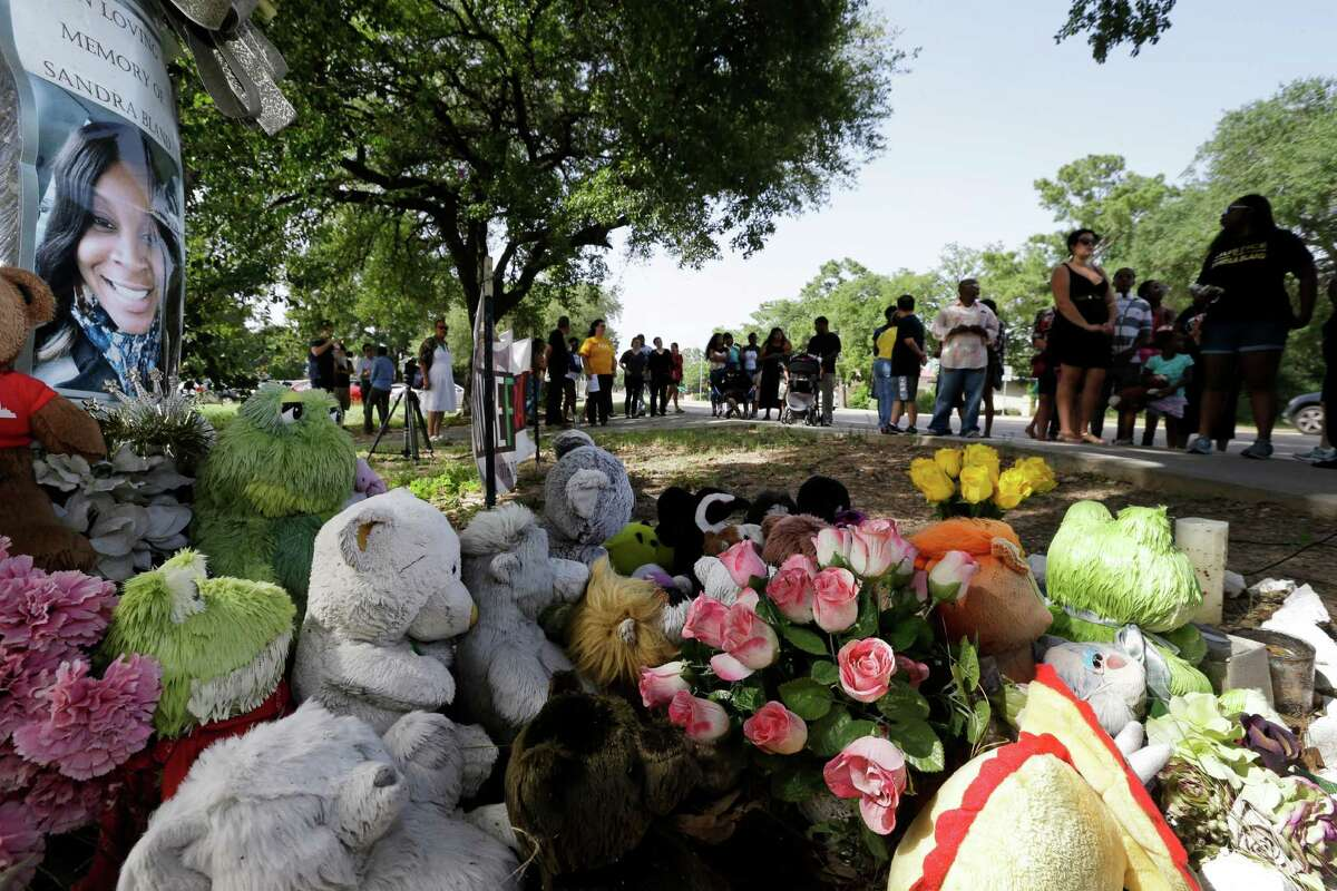 People mark the anniversary of the arrest of Sandra Bland at the Prairie View site where she was arrested.