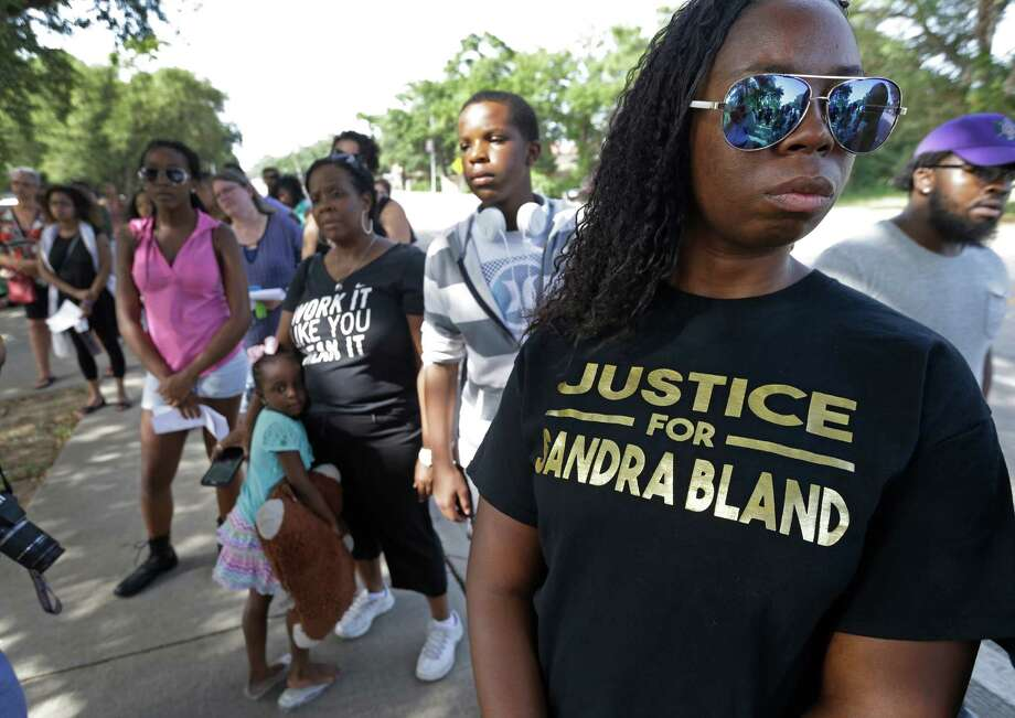 Andrea Jackson, right, of Houston, and and others commemorate the first anniversary of the arrest of Sandra Bland. Three days after her arrest, Bland was found hanging dead in her Waller County jail cell. Her death, ruled as a suicide, sparked nationwide outrage. Photo: Melissa Phillip, Staff / © 2016 Houston Chronicle