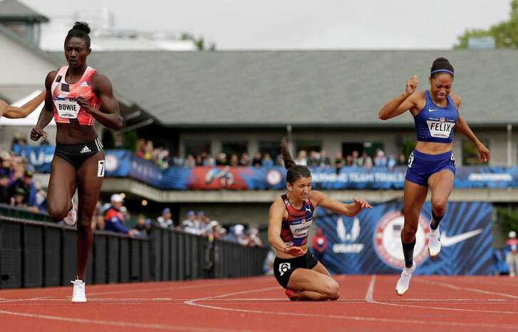 Jenna Prandini, left, falls across the  finish line, beating Allyson Felix by one one-hundredth of a second for the final qualifying spot in the 200 meters.