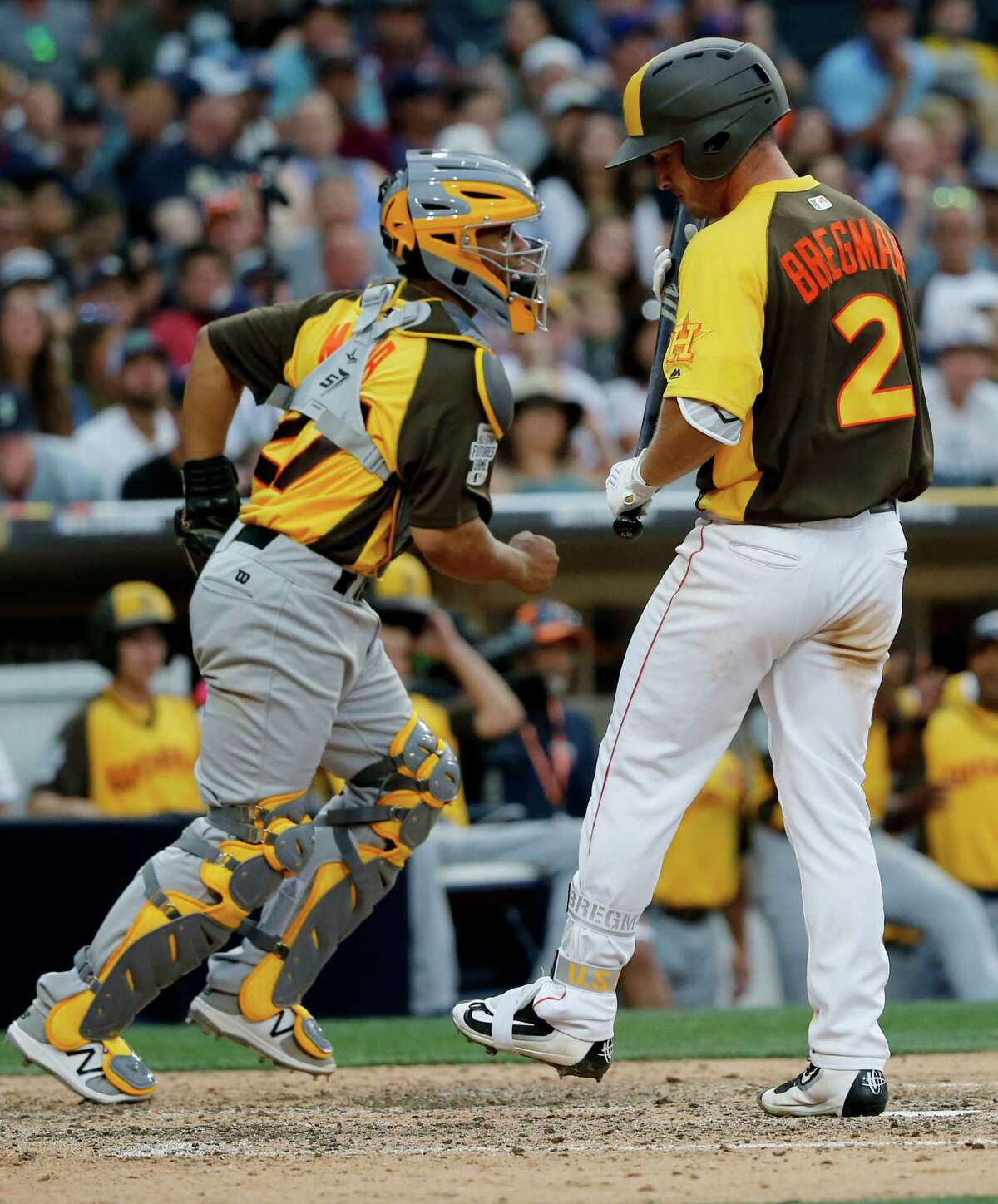 U.S. Team Alex Bregman, of the Houston Astros, strikes out to end the game as catcher Francisco Mejia, of the Cleveland Indians, celebrates after the All-Star Futures baseball game, Sunday, July 10, 2016, in San Diego. (AP Photo/Lenny Ignelzi)
