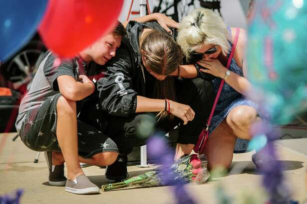 Mourners stop outside the Dallas Police Department headquarters at a memorial to officers killed in the shooting July 10. Consider the full context of what is happening in this nation.