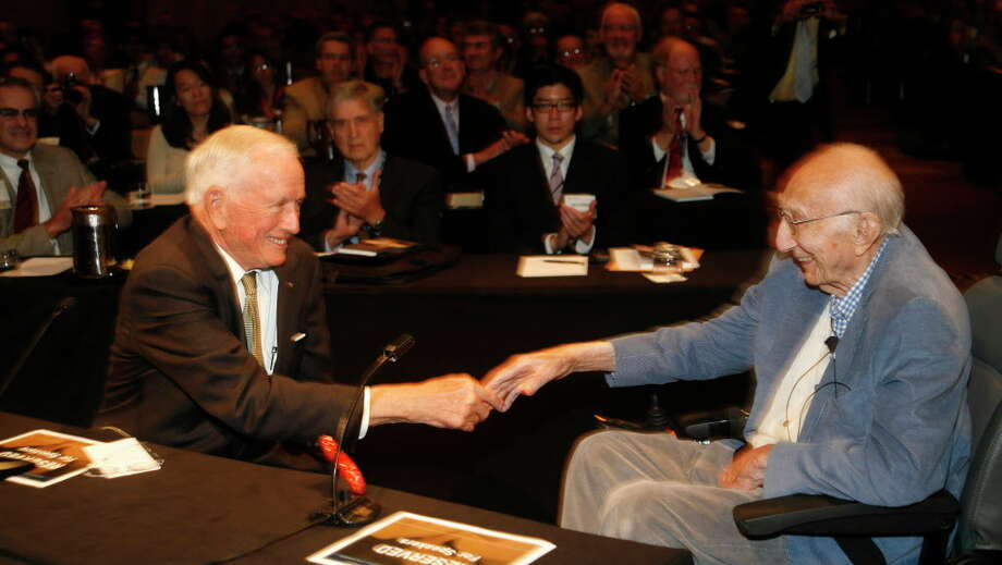Drs. Denton Cooley (left) and Michael DeBakey (right) shake hands at the 2008 meeting of DeBakey's surgical society, where Cooley was presented membership, another stride in the reconciliation between the long-feuding titans. The two mended a 40-year-long rift the year before. Photo: Steve Ueckert, Staff / © 2008 Houston Chronicle