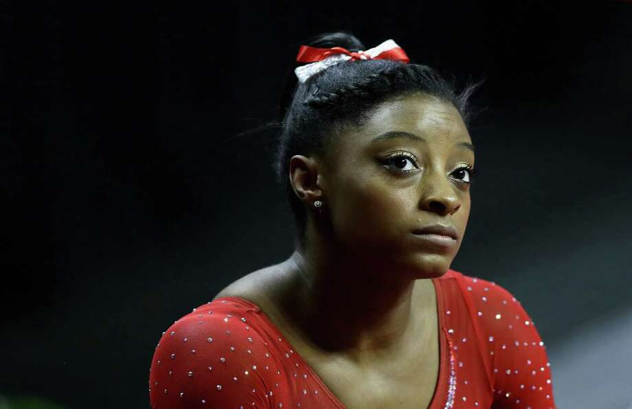 SAN JOSE, CA - JULY 10:  Simone Biles waits to warm up on the uneven bars during Day 2 of the 2016 U.S. Women's Gymnastics Olympic Trials at SAP Center on July 10, 2016 in San Jose, California. Photo: Ezra Shaw, Getty Images / 2016 Getty Images