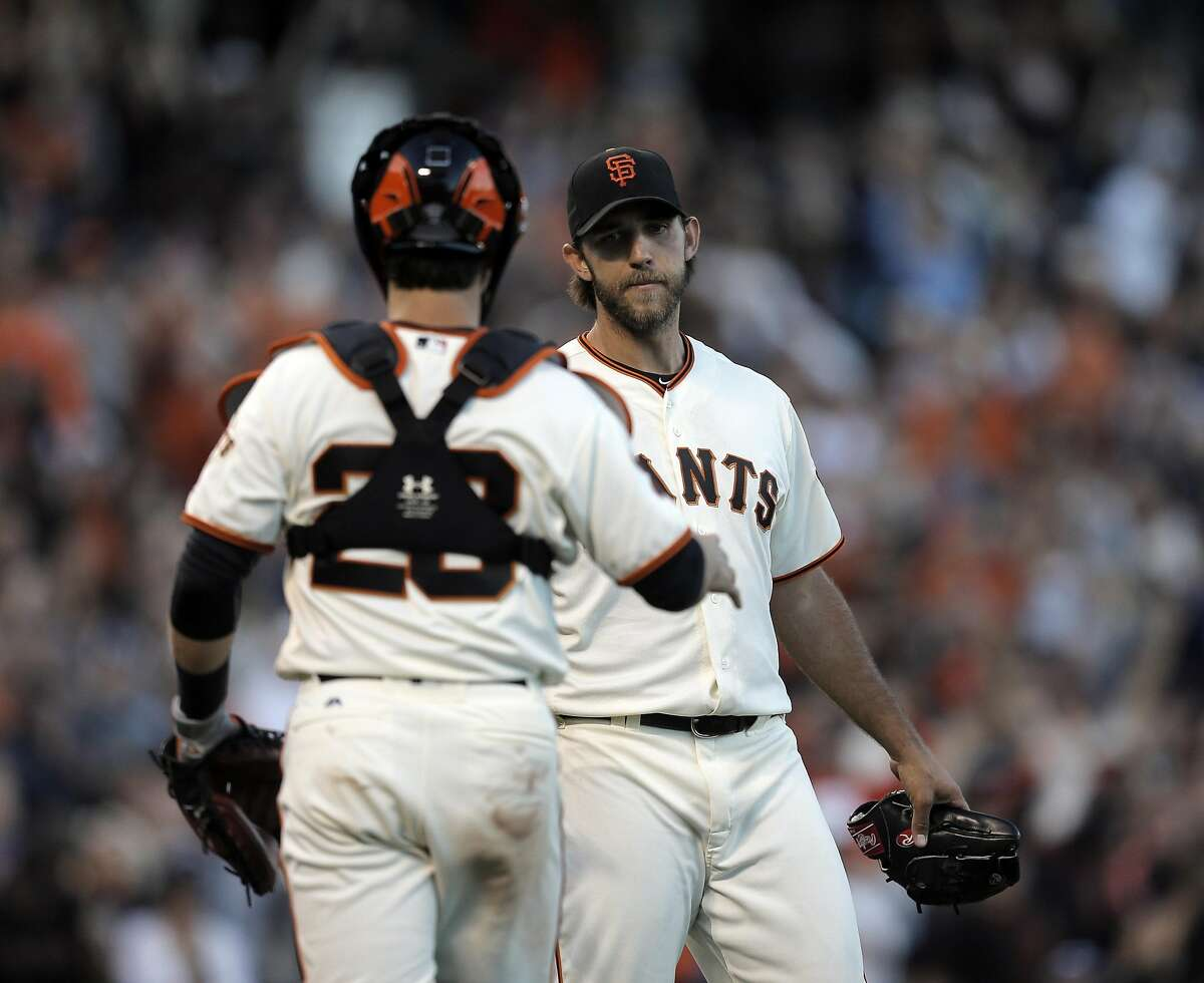 Madison Bumgarner (40) shakes hands with Buster Posey (28) after the San Francisco Giants defeateed the Arizona Diamondbacks 4-0 at AT&T Park in San Francsico, Calif., on Sunday, July 10, 2016.