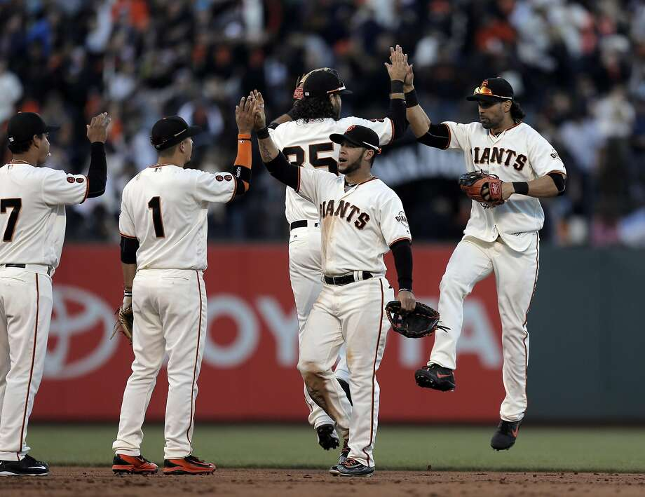 The Giants celebrated after they defeated the Arizona Diamondbacks at AT&T Park in San Francsico, Calif., on Sunday, July 10, 2016. Photo: Carlos Avila Gonzalez, The Chronicle