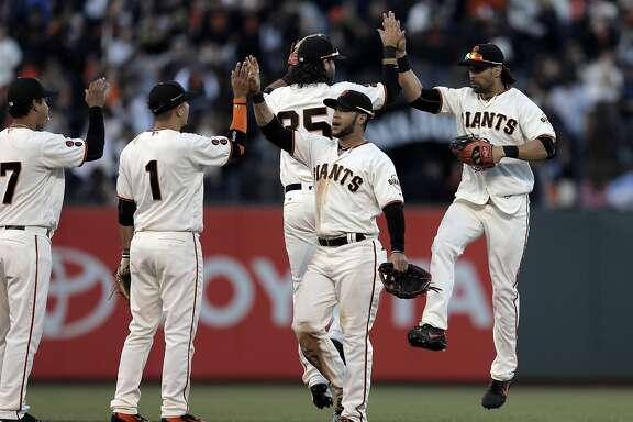The Giants celebrated after they defeated the Arizona Diamondbacks at AT&T Park in San Francsico, Calif., on Sunday, July 10, 2016.