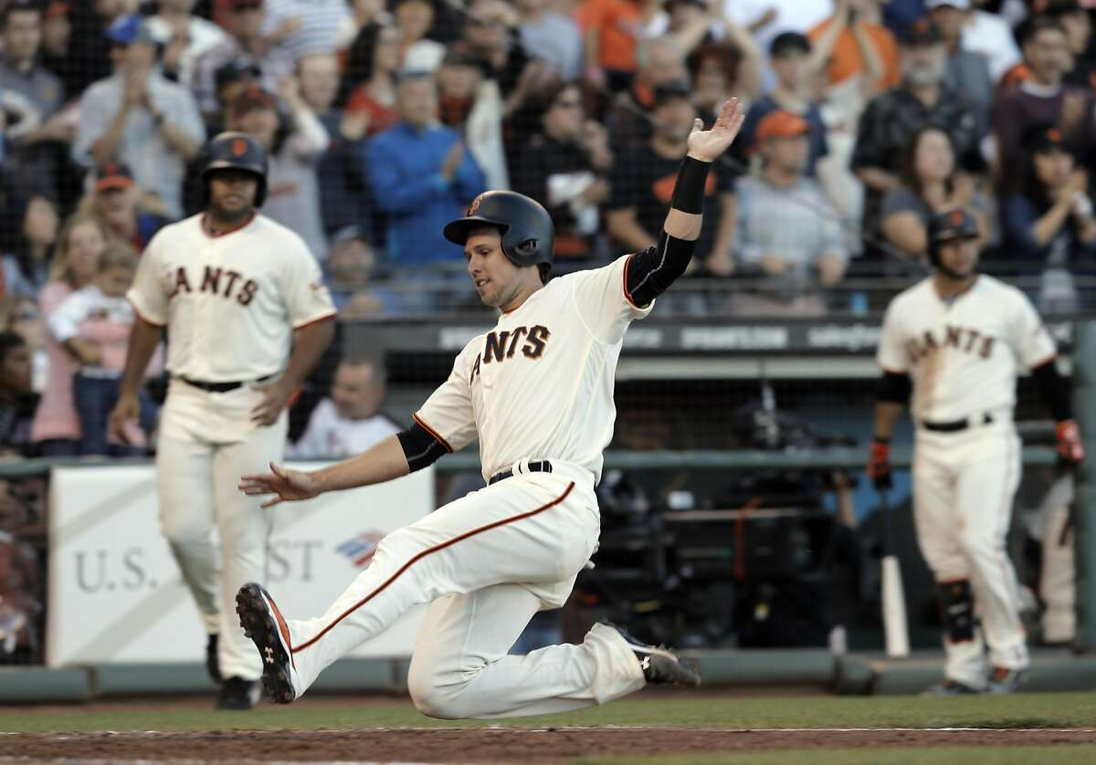 Buster Posey (28) scores in the seventh inning on a Brandon Crawford (35) double as the San Francisco Giants played the Arizona Diamondbacks at AT&T Park in San Francsico, Calif., on Sunday, July 10, 2016.