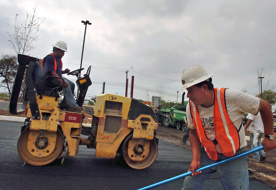 As part of a five-year-old state plan to provide incentives for regional cooperation among Connecticut's towns and cities, Oxford, Beacon Falls and Seymour will cooperate in buying new highway paving vehicles. Photo: Contributed Photo / SAN ANTONIO EXPRESS-NEWS