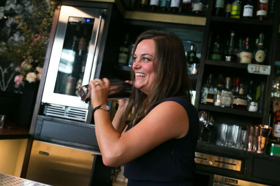 Karri Cormican, who moved to Wildhawk from Comstock Saloon, shakes up a drink at the bar designed with ornate, Victorian flair. The Wildhawk replaced the beloved and scruffy Lexington Club lesbian bar in the ever-changing Mission. Photo: Jen Fedrizzi, Special To The Chronicle