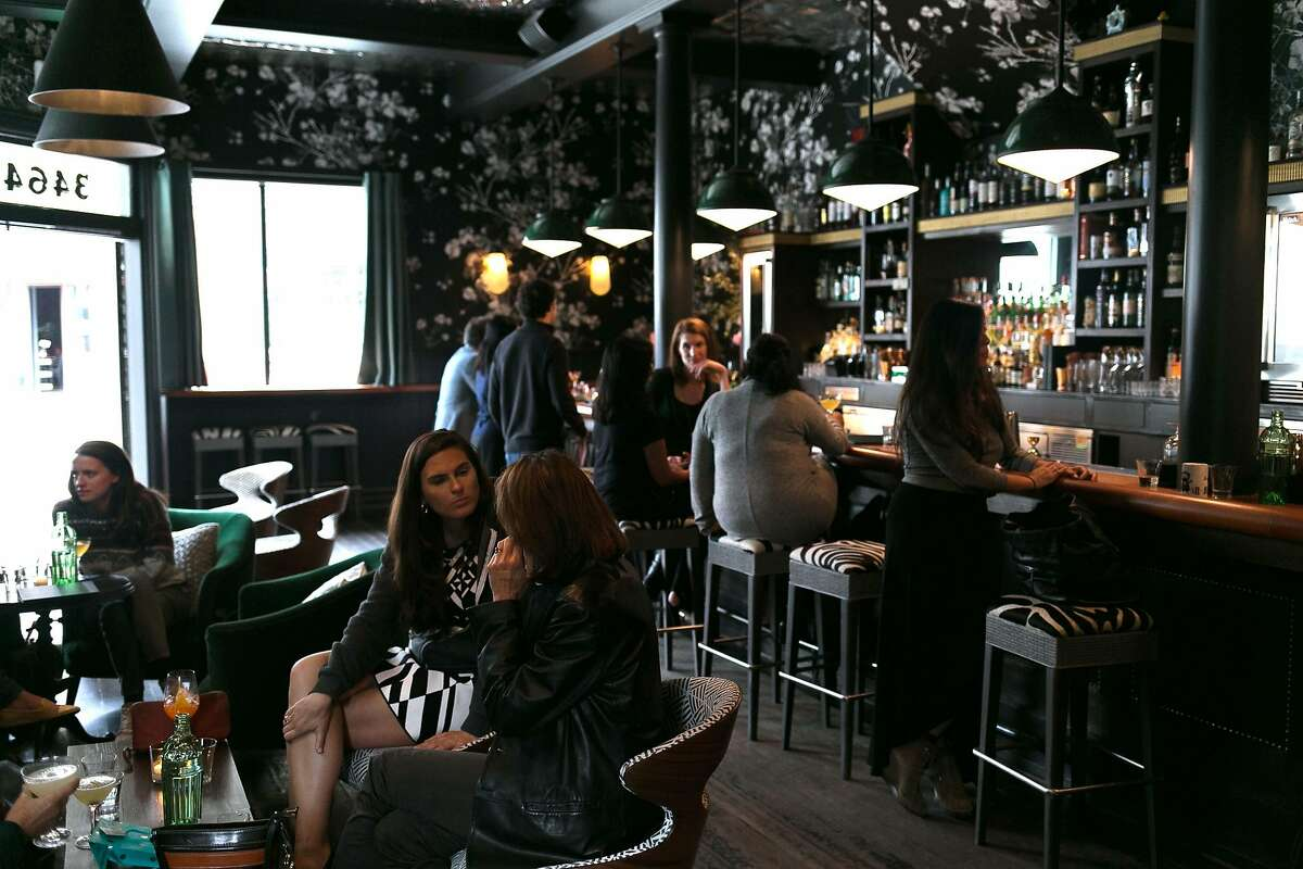 People have drinks at Wildhawk in S.F.