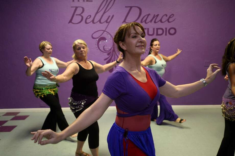 Michele Harrington, owner of The Belly Dancing Studio, leads a class at the studio. Harrington has been teaching and performing belly dancing for 15 years under the stage name Dilara Sultan.  Photo taken Tuesday 6/28/16 Ryan Pelham/The Enterprise Photo: Ryan Pelham/The Enterprise