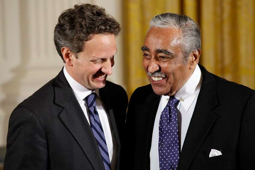 WASHINGTON - APRIL 26: Treasury Secreatary Timothy Geithner (L) and Rep. Charles Rangel (D-NY) share a laugh before a ceremony recognizing the World Series champion New York Yankees in the East Room of the White House April 26, 2010 in Washington, DC. President Barack Obama welcomed the Yankees to the White House for a ceremony celebrating their 2009 championship. (Photo by Chip Somodevilla/Getty Images) *** Local Caption *** Charles Rangel;Timothy Geithner
