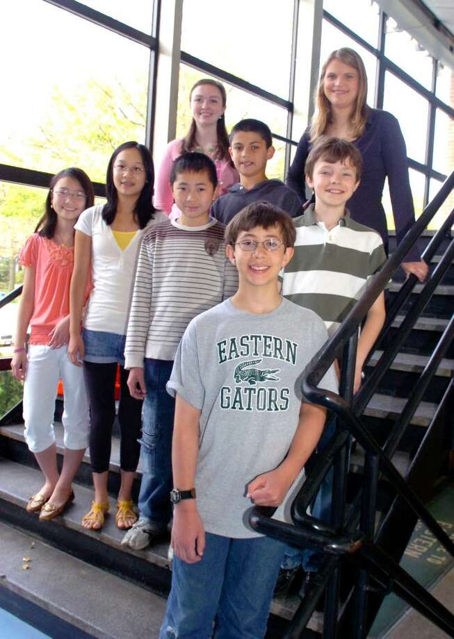 "Michael Kural, 12,front, a Eastern Middle School student at Riverside,  who will represent Connecticut in the national ""Math Counts"" competition after winning a state-wide contest last month, stands with his teammates and teachers at the school on Wednesday, April 21, 2010. The teammates are, from left, fifth and sixth graders, Jessica Cheng, Julia Wang, Matthew Wan, Nicholas Jayakar, and Max Marcussen.  The teachers, Tara Hoffman, left and Emily Carter. Photo: Helen Neafsey / Greenwich Time"