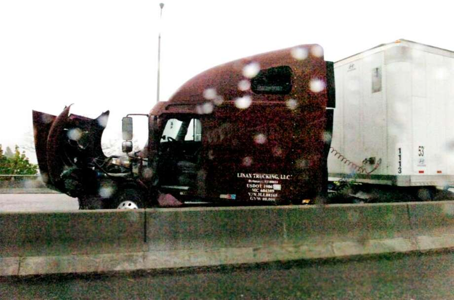 The truck involved in an accident on I-95 southbound on the Mianus River bridge on Monday,  April 26, 2010. Photo: Helen Neafsey / Greenwich Time