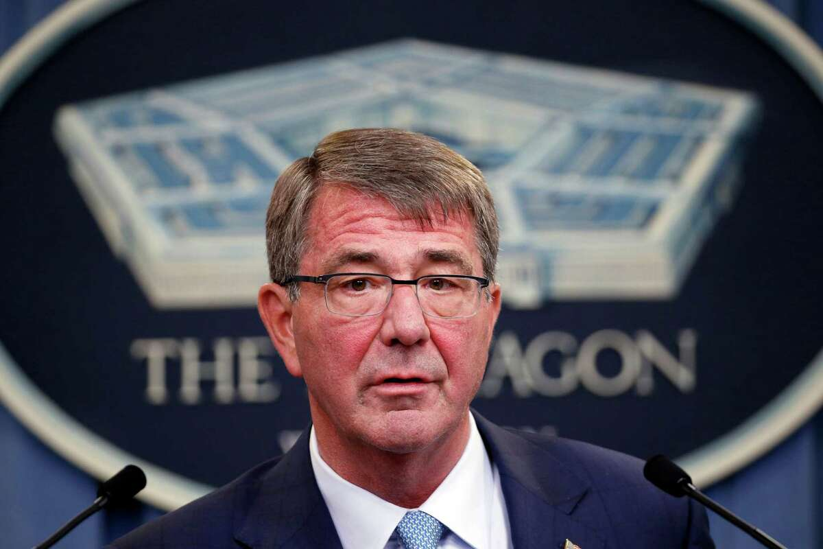 FILE -- In this Thursday, June 30, 2016 file photo, Defense Secretary Ash Carter speaks during a news conference at the Pentagon. As Carter arrived in Iraq, Monday, July 11, 2016, he said U.S. and coalition forces will use the newly retaken air base in Qayara as a staging hub as Iraqi security forces move closer to the long-awaited battle to recapture Mosul from Islamic State militants. Carter landed in Baghdad on an unannounced visit and says U.S. advisers are prepared to accompany Iraqi battalions, if needed, as those units move closer to the fight for Mosul.