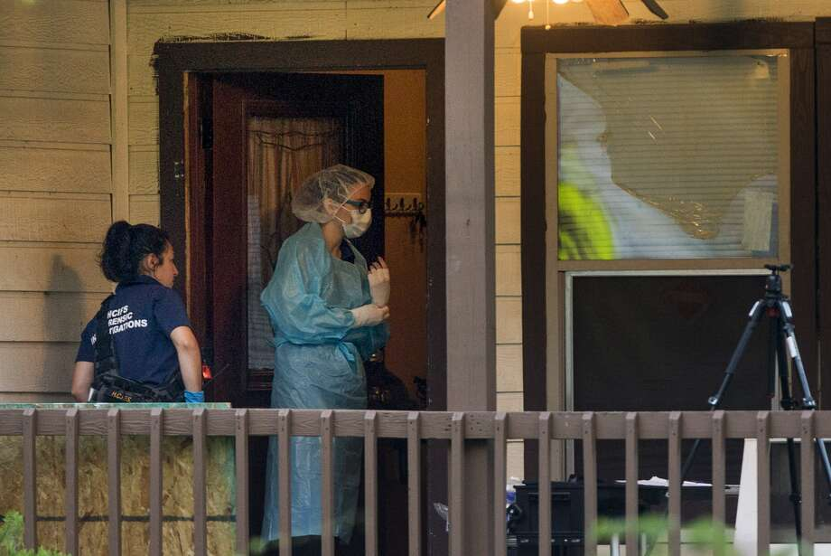 Police investigate the scene where a body was discovered inside a home in the 2800 block of Dover on Monday, July 11, 2016, in Houston. ( Brett Coomer / Houston Chronicle )