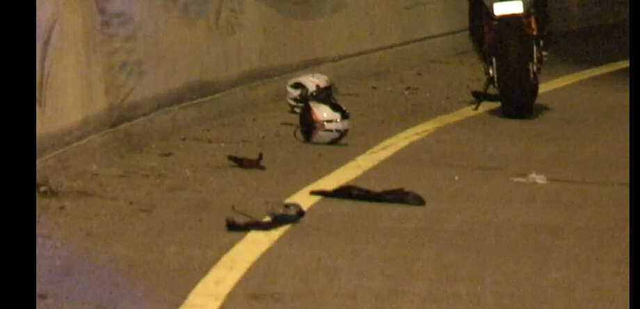 A woman died in a motorcycle crash about 12:30 a.m. Monday, July 11, 2016, when she plunged about 40 feet from an elevated portion of the Katy Freeway near the West Loop in west Houston. (Metro Video)