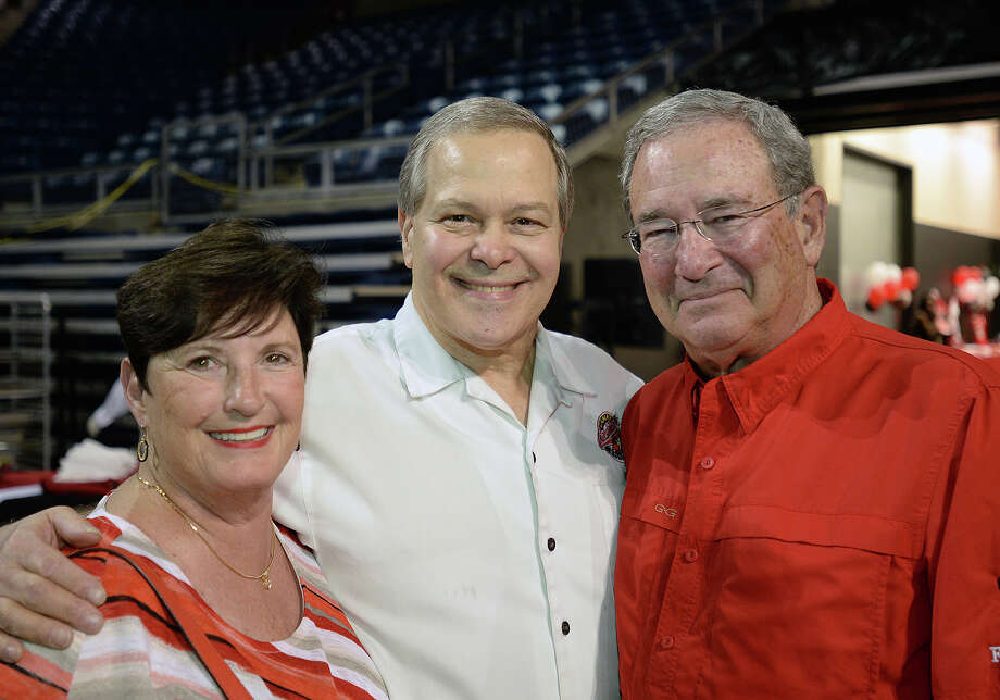 From left, Susan Simmons, Frank Messina and Jimmy Simmons during Lamar's football banquet at Ford Park Sunday night.  Photo taken Sunday, August 23, 2015 Guiseppe Barranco/The Enterprise Photo: Guiseppe Barranco, Photo Editor